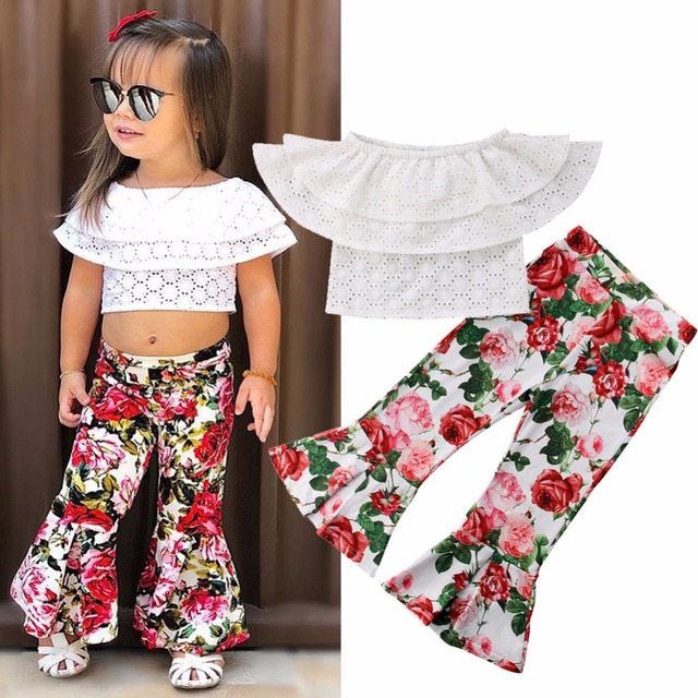 fa0bc603cd7 Baby Girls Clothing Sets New Design Hollow Out Boat Neck Tops Sleeveless  Floral Flare Pants 2PCS Bebe Kids Girls Clothes Suits