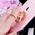 Fashion de señora girl amor anillo de metal titular de la tableta del teléfono móvil de palo-ons asidero para iphone7 plus xiaomi coche soporte