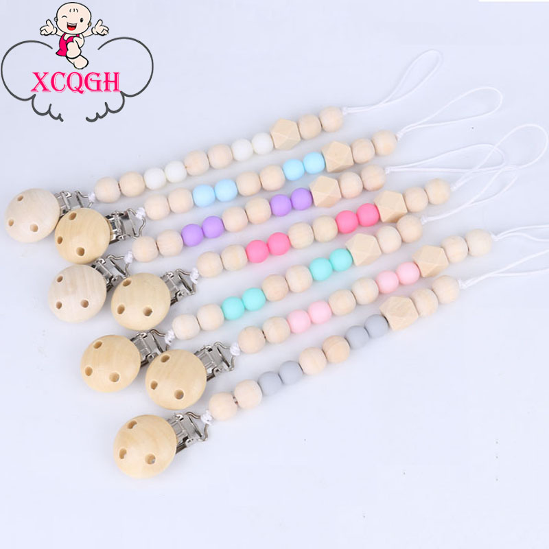 купить XCQGH Baby Pacifier Clip Chain Wooden Holder Chupetas Soother Pacifier Clips Leash Strap Nipple Holder For Infant Feeding по цене 82.96 рублей