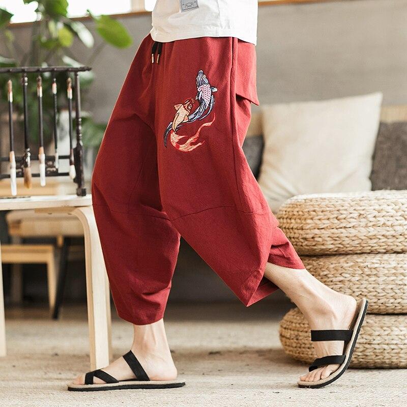 Neuf de haute qualité de style Chinois broderie moyen taille élastique bande tendance multicolore fit large de jambe hommes pantacourt