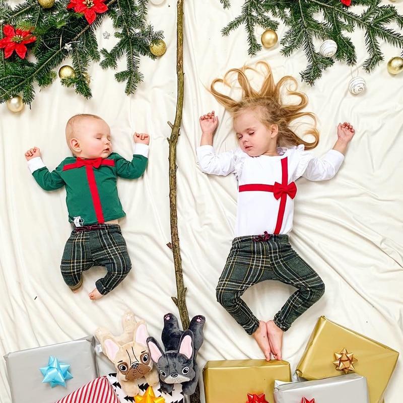 Little brother and big sister matching Christmas pajamas