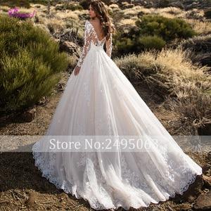 Image 2 - Glamorous Gericht Zug Appliques Spitze A Line Hochzeit Kleid 2020 Sexy Scoop Neck Blumen Langarm Prinzessin Braut Kleid Plus Größe