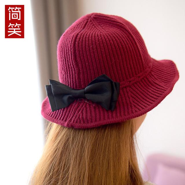 Invierno de las señoras Sombrero de la cinta Coreana de punto sombrero casquillo de lana blanco y negro plegable ocio plano de marea a lo largo de la cúpula