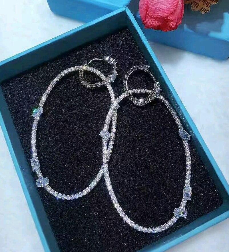Sinzry exagerada grandes círculo oval pendientes elegante blanco claro cut cubic zirconia partido cuelgan los pendientes para las mujeres