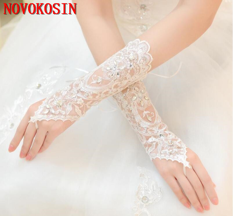 Купить с кэшбэком 2019 Luxury Short Lace Bride Bridal Gloves Wedding Gloves Crystals Wedding Accessories Lace Gloves for Brides Fingerless Wrist