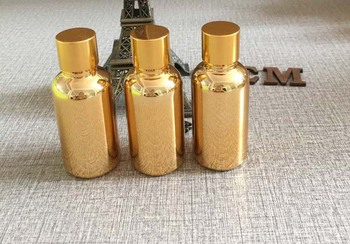 100pcs high grade 30ml glass bottle oil bottles wholesale,luxury empty golden 1 ounce glass bottle of essential oil for sale