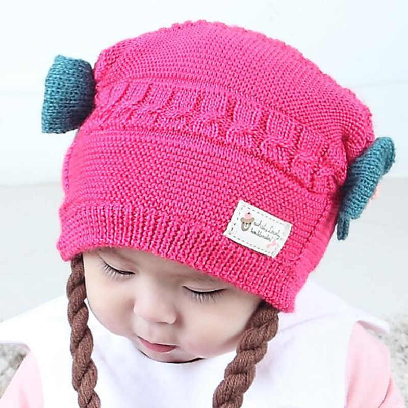 bc2f747aa09 ... Cute Baby Wig Hats Bow-knot Newborn Baby Girls Knitted Braids Hat  Infant Caps Warm ...