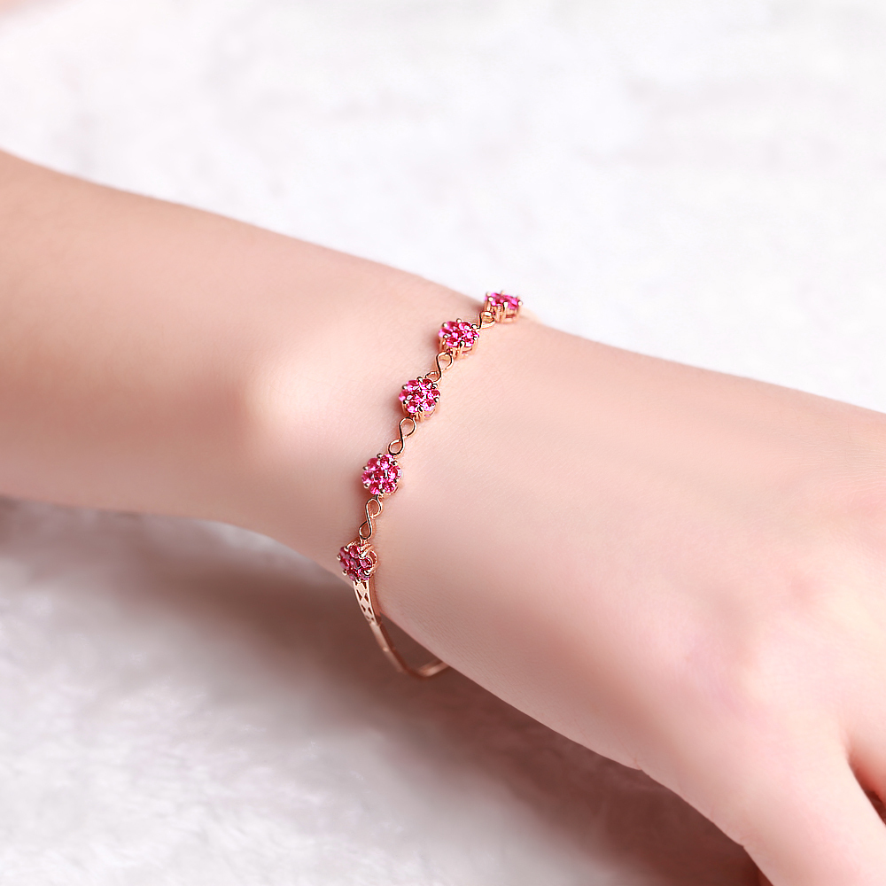 close with gold dark eye up bracelet rose ruby diamond red evil pink
