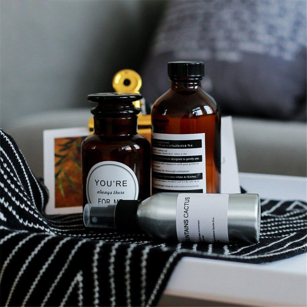 Frasco de armazenamento de vidro marrom escandinavo com adesivo chique aromaterapia garrafa de óleo essencial nordic flor rattan vaso fotografia p