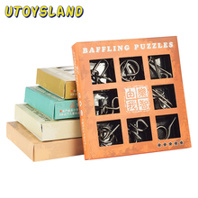 цена UTOYSLAND 9pcs/set Metal Puzzle Wire IQ Mind Brain Teaser Puzzle Kids Game Toys for Children Adults Baby Montessori Toys онлайн в 2017 году
