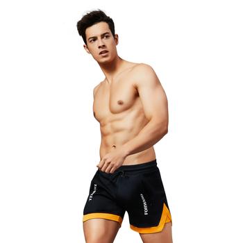 2019 gorąca sprzedaż męskie spodenki do biegania siłownia sportowa kulturystyka krótkie spodnie dresowe człowiek plaża spodenki elastyczny Jogging bryczesy tanie i dobre opinie Szorty Tenis Poliester spandex Patchwork Suknem 95043 Pasuje prawda na wymiar weź swój normalny rozmiar Hank Wolf