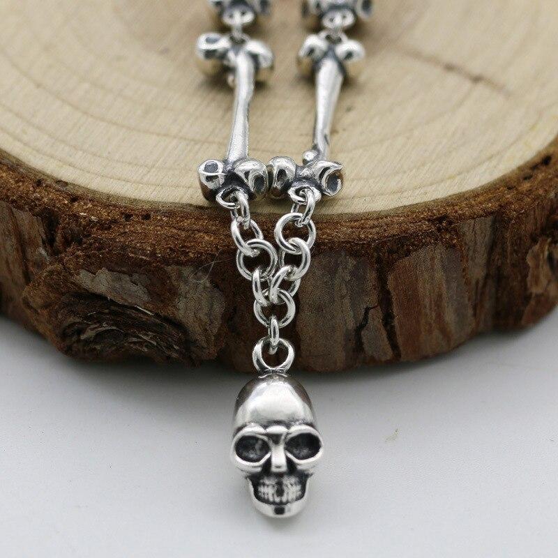 Здесь можно купить  S925 Sterling Silver Wholesale Thai Silver Retro Bone Chain Fashion Silver Skeleton Skull Pendant Men And Women Sweater Chain  Ювелирные изделия и часы