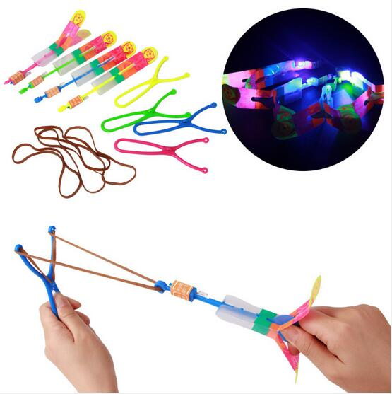 US $26 87 5% OFF|Glow in the Dark Yellow Green Blue Pink Large LED Light  Slingshot Elastic Arrow Rocket Helicopter Flying Toy Party Fun Gift-in