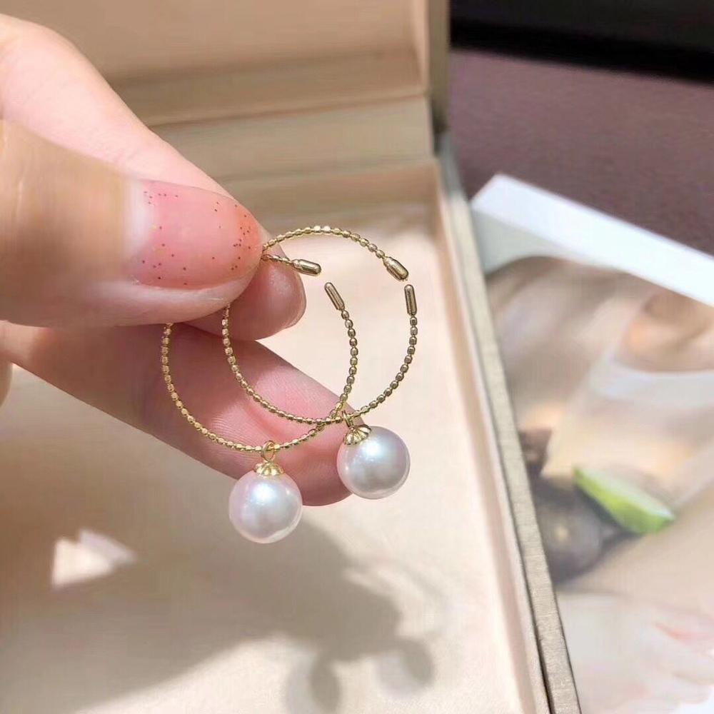 elegant pair of 10-11mm south sea round white pearl earring 18kelegant pair of 10-11mm south sea round white pearl earring 18k