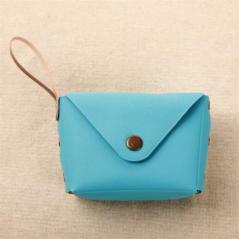 2017 new ideas Macaron hand holding a small lady cute candy color bag key packing earphone line coin wallet