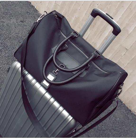 938062bb9b5e placeholder Famous Brand Large-capacity Folding Portable Men Women Travel Bag  Waterproof Solid Duffle Bag Luggage