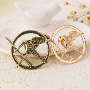 Image 2 - Hunger Games Brooch Pin Bird Eagle Arrow Logo Badge Vintage Fashion Hot Animal Game Movie Jewelry For Men Women Kids Wholesale