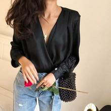 BOHO INSPIRED Black Flowy bodysuit deep V-neck long sleeves cuffs Bottom