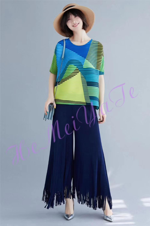 ¡Envío gratis! pantalones Miyake con flecos de moda de color puro y diseño artístico en STOCK