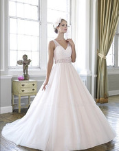 ball gown micro-beaded floral sash Soft tulle pleated draped sweetheart bodice creating illusion sleeves bridal wedding dress