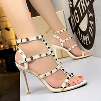 Summer women shoes European style retro sexy sexy high heeled shoes leather club metal rivets sandals shoes