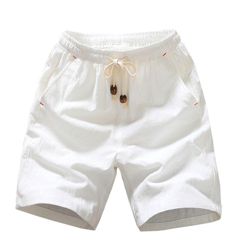 2018 verano nuevos pantalones cortos de algodón suelto para hombres, pantalones cortos casuales blanco y negro en la cintura con cordón de ajuste de las Bermudas pantalones cortos Hombre tamaño 4XL 5XL