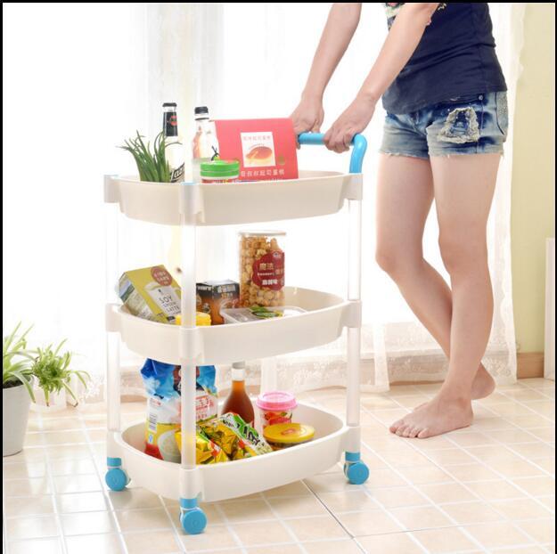 Le support de plancher des étagères de cuisine en plastique multicouche peut être déplacé avec une roue de ceinture mobile