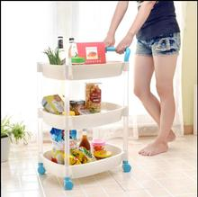 The floor rack of multi-layer plastic kitchen shelves can be moved with a movable belt wheel