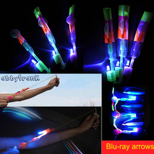 Abbyfrank 20Pcs/Set Arrow Rocket LED Toy Flashing Flying Outdoor Fun Sports Toys Rocket Copter Slingshot LED Crossbow Helicopter(China)