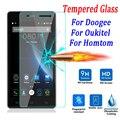 9 h templado protector de pantalla de cristal para doogee x5 x6 pro 550 f5 Y100 Homtom HT6 Ht3 Ht7 Pro Oukitel K4000 K6000 Película Caja Del Teléfono