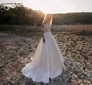 Image 4 - Vestido de noiva2020 nouveau O cou dentelle satin une ligne ivoire plage boho robe de mariée queue suknia slubna gelinlik casamento