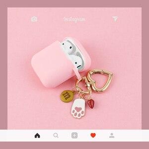 Image 3 - Màu Hồng Dễ Thương Silicone Rung Phụ Kiện Tai Nghe Bluetooth Chụp Tai Hoạt Hình Bảo Vệ Thỏ Móc Khóa