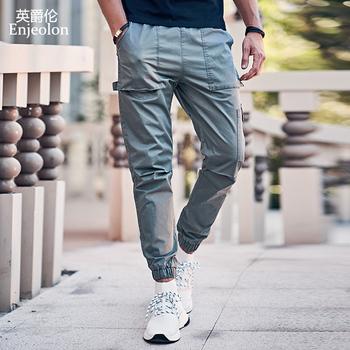 Enjeolon 2020 nowe letnie męskie spodnie Cargo mężczyźni biegaczy wojskowe dorywczo trwała bawełna spodnie Hip Hop męskie spodnie wojskowe KZ6345 tanie i dobre opinie Cargo pants CN (pochodzenie) Pełnej długości Plisowana REGULAR COTTON Midweight Suknem Pockets Elastyczny pas Dark gray Army green Khaki Black