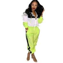 купить 2019 spring women's hooded casual jumpsuit stitching contrast color sexy jumpsuit long sleeve pants tights по цене 1108.53 рублей