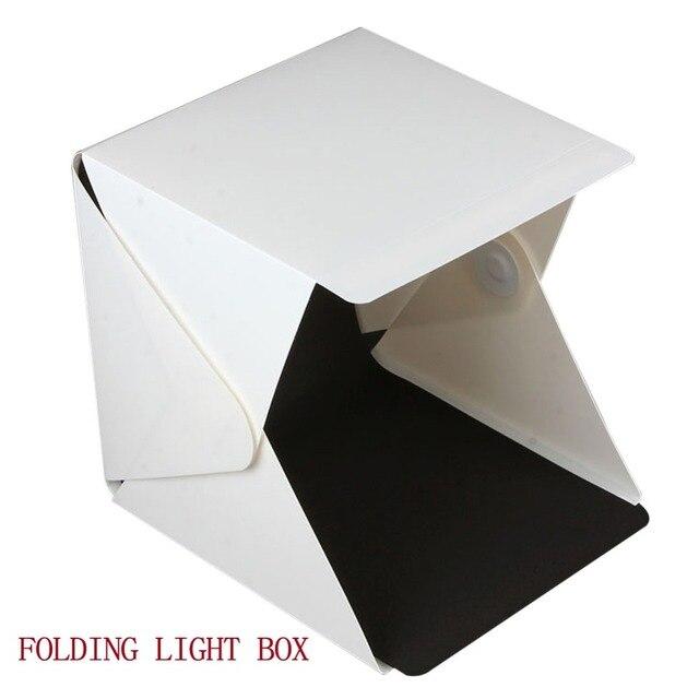 https://ae01.alicdn.com/kf/HTB1C1TrNXXXXXX6XXXXq6xXFXXX5/Gratis-verzending-Fotografie-Vouwen-Mini-Studio-Led-verlichting-Box-voor-Foto-zowel-Telefoon-of-DSLR-Camera.jpg_640x640.jpg