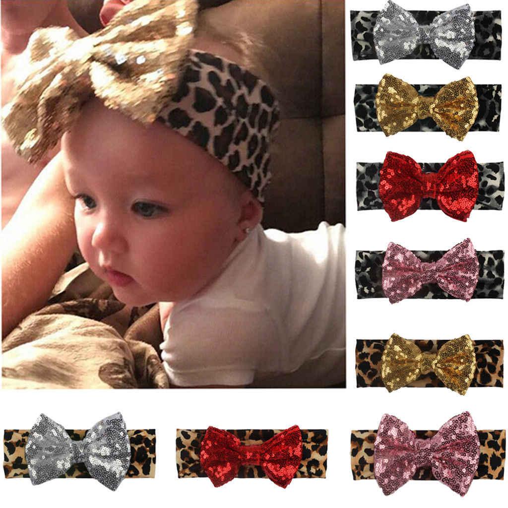 Venta caliente niñas niños bebé leopardo estampado lazo diadema estiramiento turbante