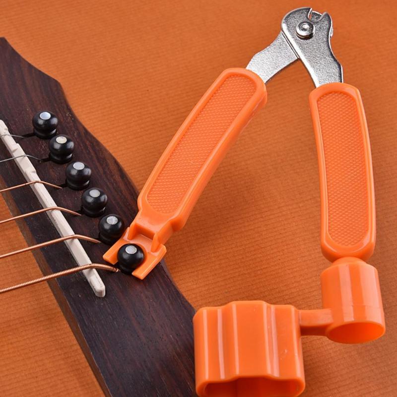 3 in 1 multifunction guitar tool guitar peg string winder string pin puller string cutter. Black Bedroom Furniture Sets. Home Design Ideas