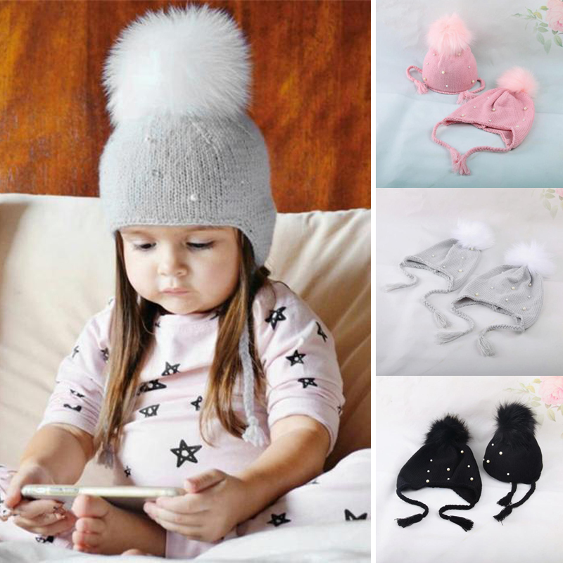 32b25078486 Winter Cute Baby Girls Kids Pearl Faux Fur Pom Bobble Strap Hats Pink Black  Grey Warm Knit Beanie Hat Cap Accessories