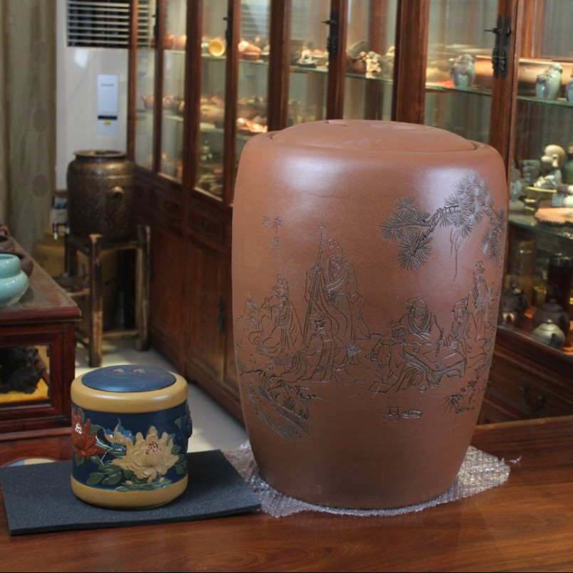 The tea storage tank size Zisha tea cylinder full hand carving Yixing Yixing tea mug mixed batch professional deposit the direct origin of yixing yixing tea wholesale high hand carved pattern store tank mixed batch