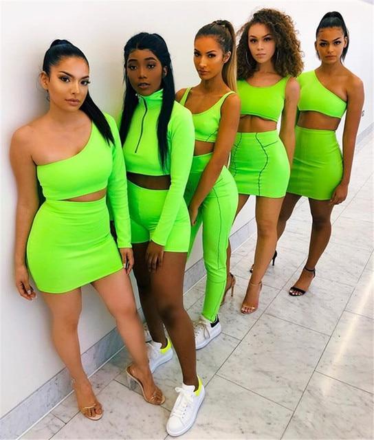 KGFIGU femmes ensembles 2019 nouveaux arrivants une épaule orange et vert deux pièces ensembles sexy hauts et jupes survêtements ensembles assortis 2