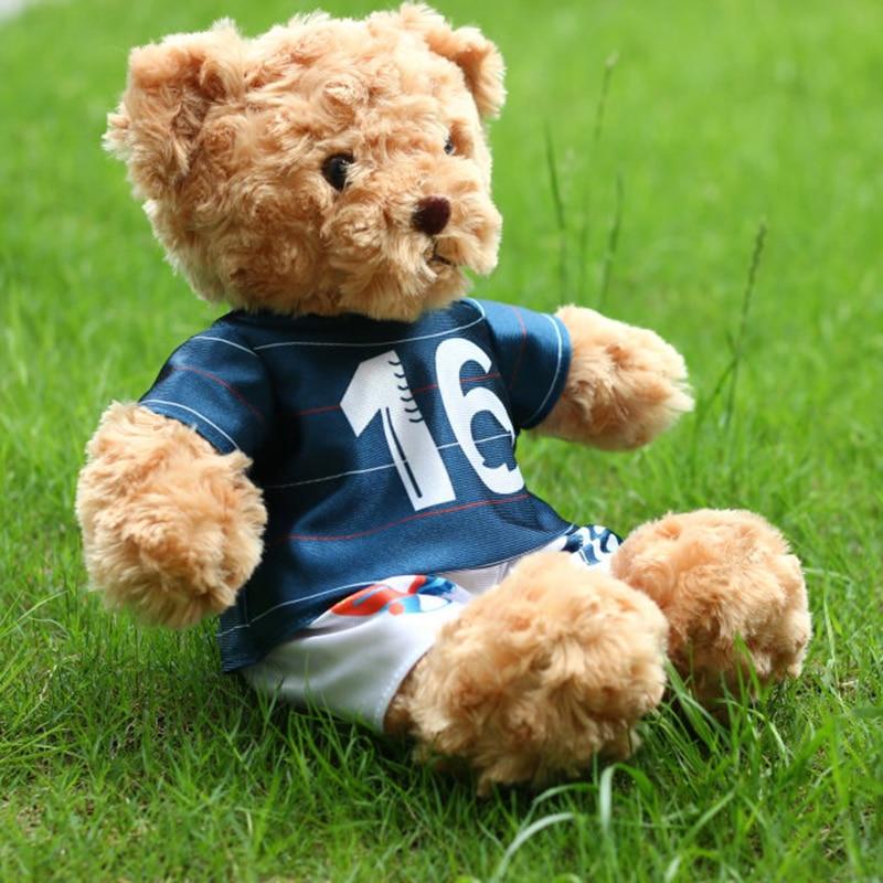 2016 sittande höjd 25cm fotboll Minnesbjörn, nallebjörn plysch leksak, nallebjörnduk klänning, fri frakt!