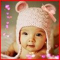 Um chapéu de ouvido rosa Lindo chapéu de Natal cap Bowknot Inverno Earflap infantil & Fotografia Da Criança para o bebê Recém-nascido meninas Mais Quente