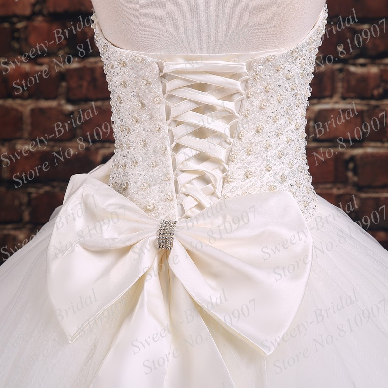 New Princess Strapless Ball Gown Wedding Dresses 2016 Beaded Pearls Crystals Bow Lace Up Back Ivory Bridal 7a378 In From Weddings