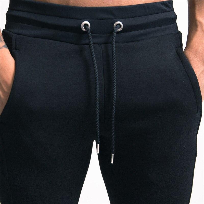 Image 4 - YEMEKE 2019 Elasticity Mens Joggers Pants Casual Fashion Bodybuilding Joggers Sweatpants Bottom Printing Pants Men Casual Pants-in Sweatpants from Men's Clothing