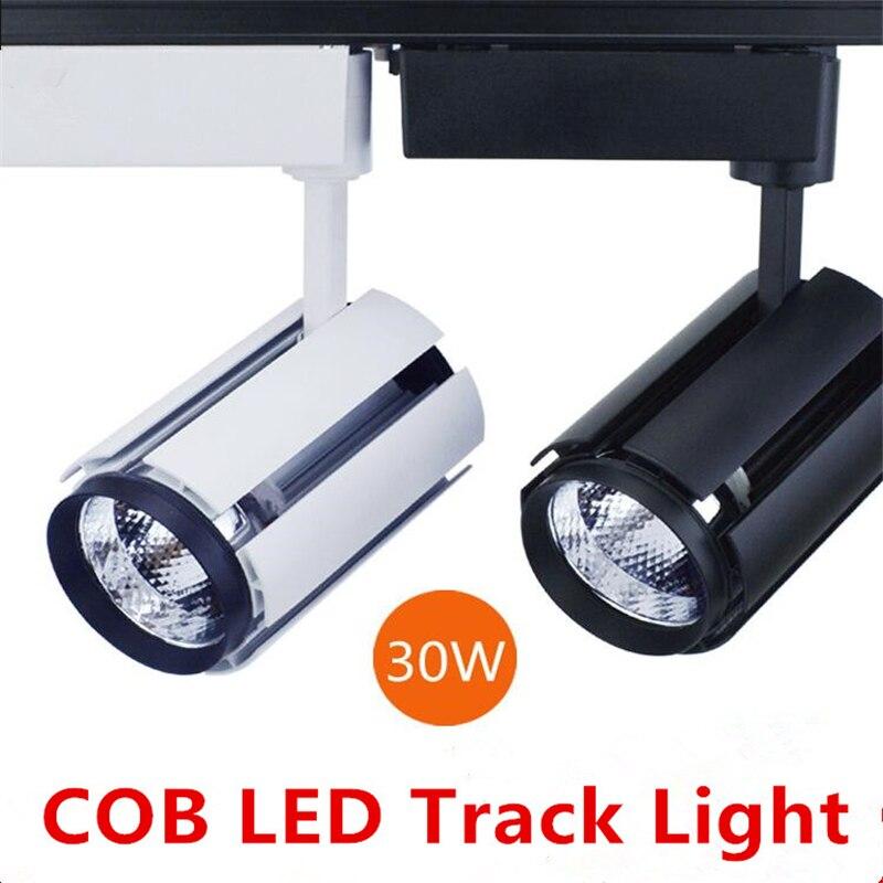 8pcs lot wholesale 30w cob led track light bulb 85 265 volt led wall track lighting white shell black shell