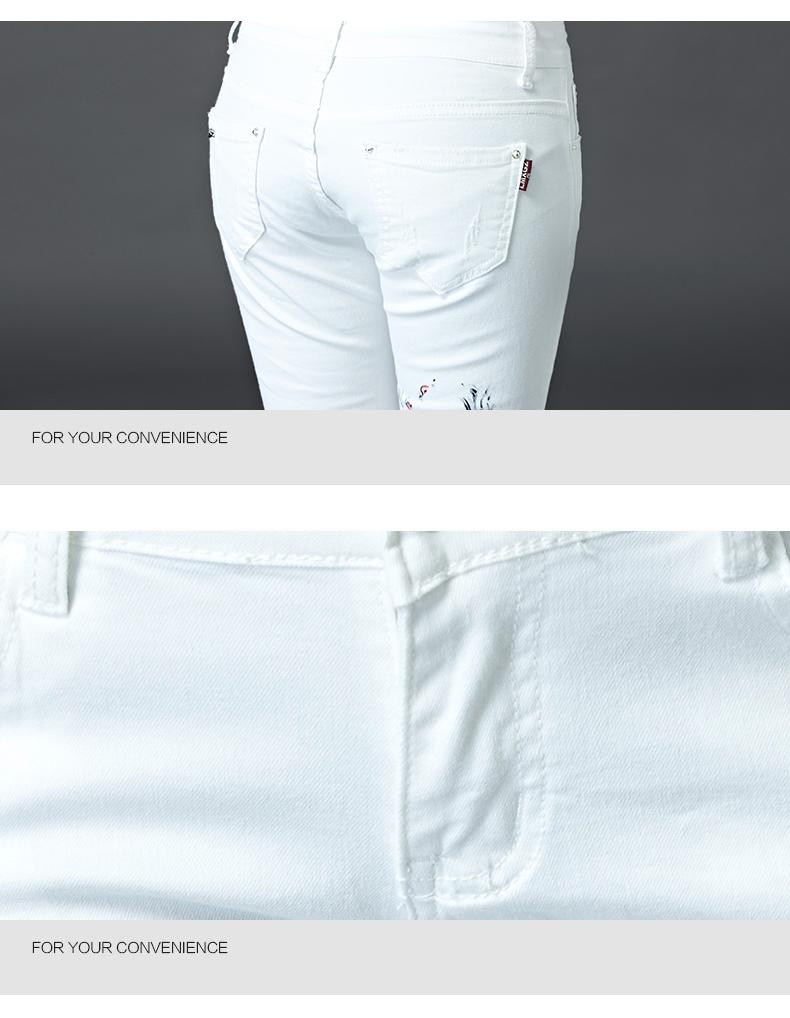 Naise pildiga valged püksid