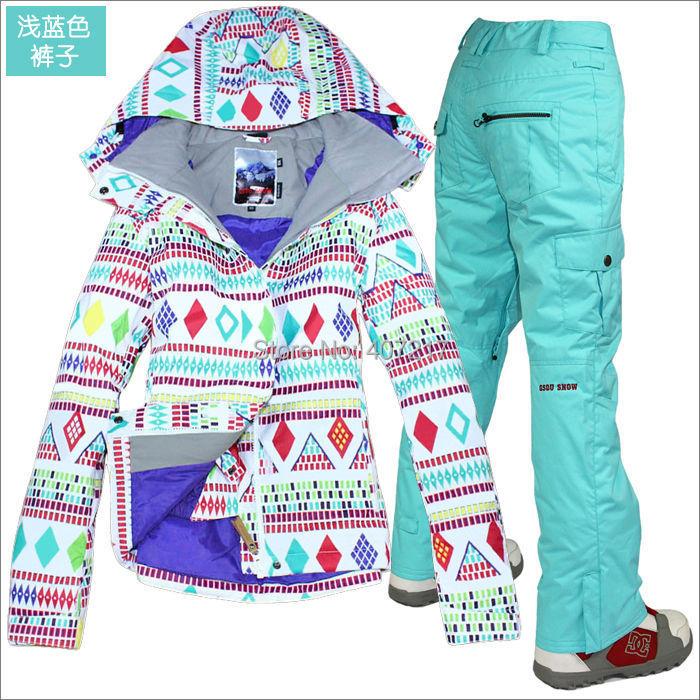 Prix pour 2014 femmes mesdames combinaison de ski snowboard costume ski costume femmes blanc avec coloré losange veste et pantalon bleu de neige porter vêtements de ski