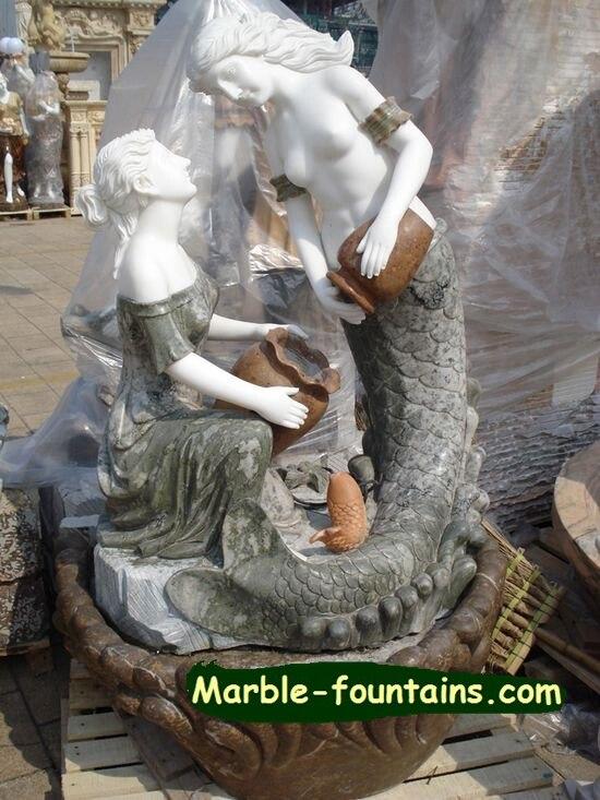 Dalam ruangan batu Air terjun putri duyung patung patung