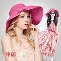 2016 marca de moda das senhoras das mulheres Summer Beach panamá aba larga chapéu de sol dobrável de palha feminino Cap com arco da fita B-3183