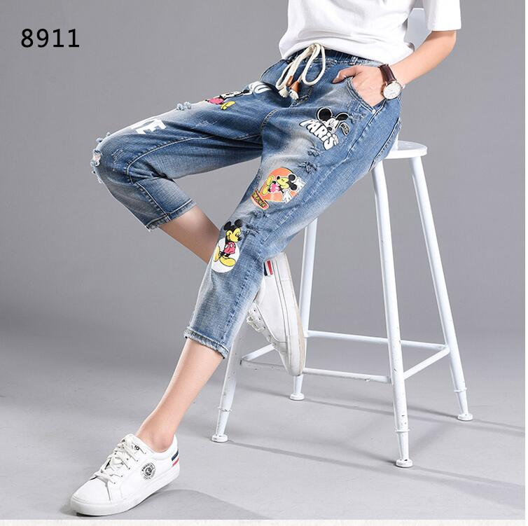 Stretch waist broken hole jeans female summer loose leisure Haren big size cartoon print pants